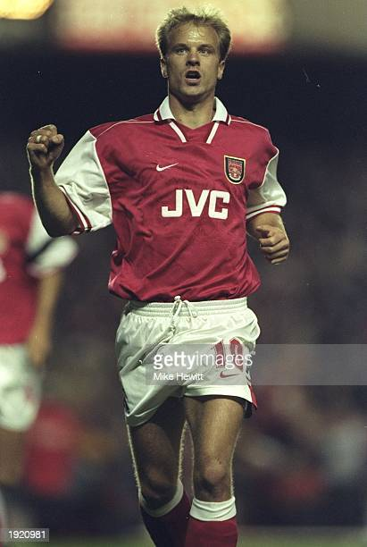 Dennis Bergkamp of Arsenal celebrates a goal during the UEFA Cup first round second leg match against Paok Salonika at Highbury in London The match...