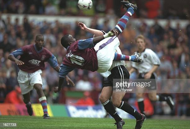 Dwight Yorke of Aston Villa attempts an overhead kick during the FA Carling Premiership match against Derby County at Villa Park in Birmingham...