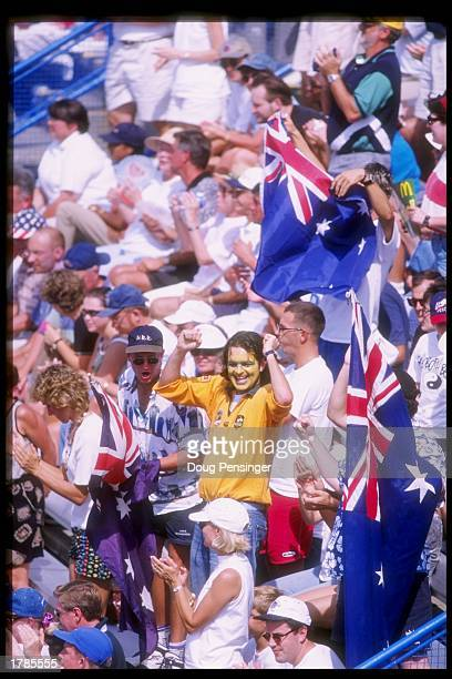 Fans celebrate during a Davis Cup Semi Final match between Pete Sampras and Todd Martin of the USA and Todd Woodbridge and Mark Woodforde of...