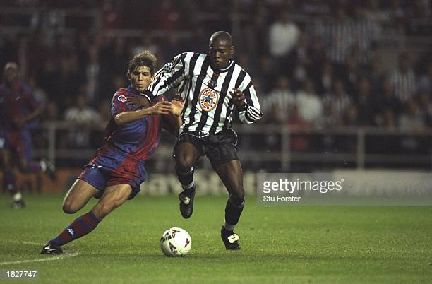 Faustino Asprilla of Newcastle holds off a tackle during the Champions League match against Barcelona at St James'' Park in Newcastle, England....