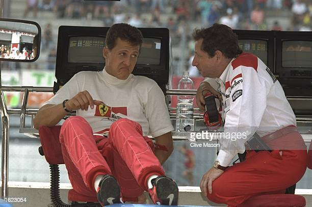 Ferrari driver Michael Schumacher of Germany discusses tactics with Jean Todt the Ferrari Team Principal on practise day of the Italian Grand Prix in...