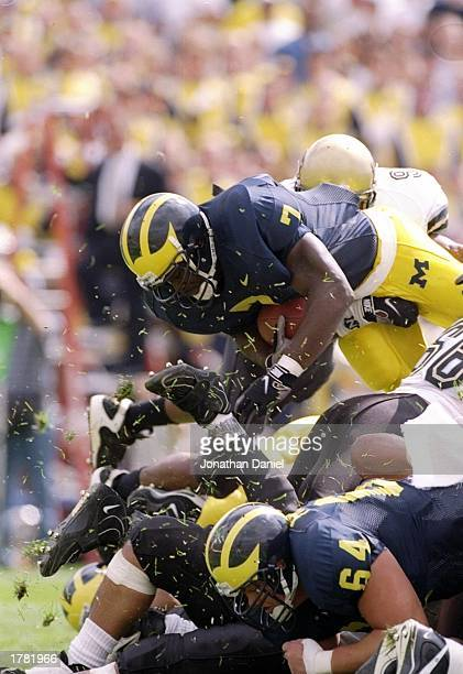 Fullback Chris Floyd and center Steve Frazier of the Michigan Wolverines in action during a game against the Colorado Buffaloes Michigan won the game...