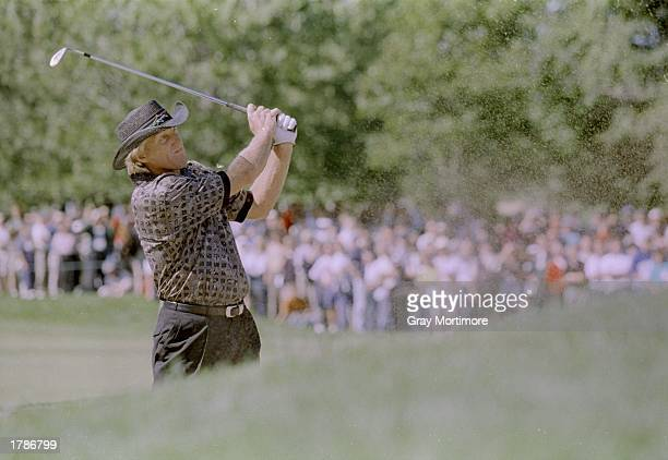 Greg Norman hits the ball during the Canadian Open at the Royal Montreal Golf Course in Montreal Quebec