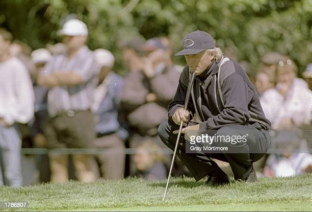 Greg Norman looks on during the Canadian Open at the Royal Montreal Golf Course in Montreal Quebec