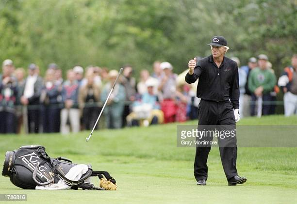 Greg Norman throws his club during the Canadian Open at the Royal Montreal Golf Course in Montreal Quebec
