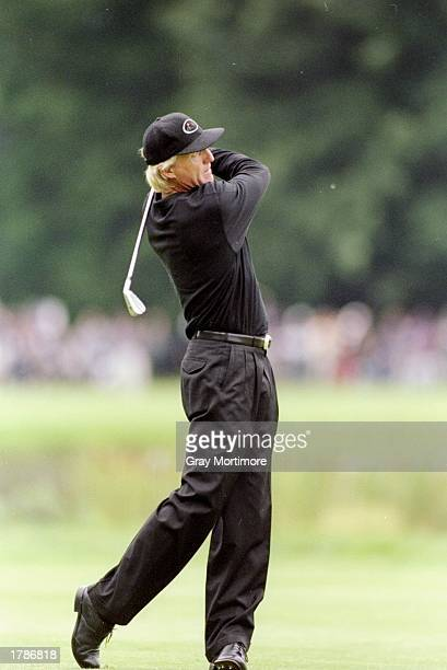 Greg Norman watches his shot during the Canadian Open at the Royal Montreal Golf Course in Montreal Quebec