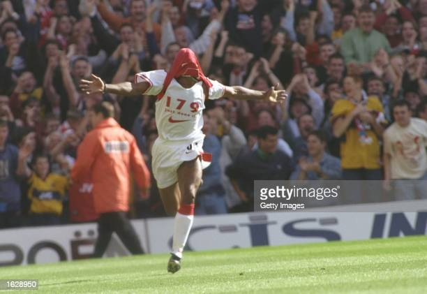 Ian Wright of Arsenal celebrates breaking the Arsenal goal scoring record set by Cliff Bastin at Highbury in London England Mandatory Credit Allsport...