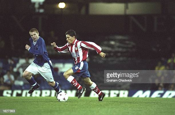 Juninho of Atletico Madrid goes past Neil Lennon of Leicester City during the UEFA Cup first round second leg match at Filbert Street in Leicester...