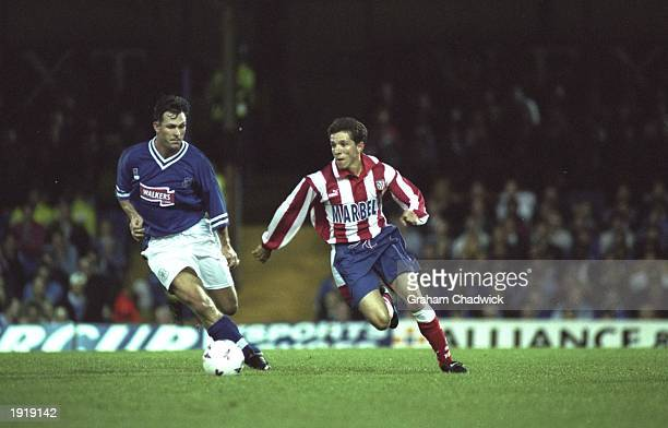 Juninho of Atletico Madrid takes on Pontus Kamaark of Leicester City during the UEFA Cup first round second leg match at Filbert Street in Leicester...