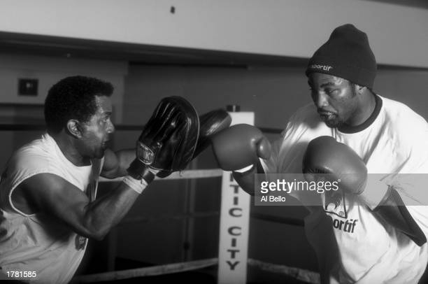 Lennox Lewis hits mitts held by trainer Emanuel Stewart during a workout for his bout with Andrew Golota in Atlantic City New Jersey Mandatory Credit...