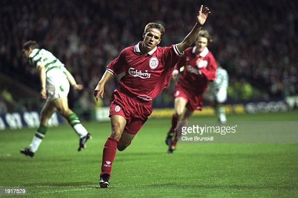 Michael Owen of Liverpool celebrates scoring a goal during the UEFA Cup First Round match against Celtic at Celtic Park in Glasgow Scotland The match...