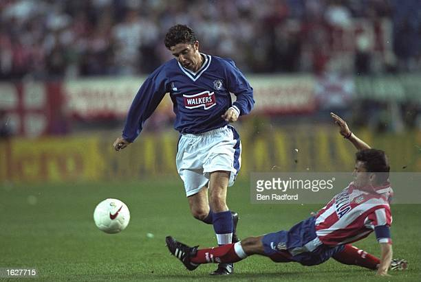 Mustafa Izzet of Leicester City is tackled during the UEFA Cup First Round match against Athletico Madrid at the Vincente Calderon in Madrid Spain...