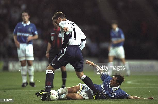 Nick Barmby of Everton tackles Alan Thompson of Bolton Wanderers during the FA Carling Premiership match at the Reebok Stadium in Bolton England The...
