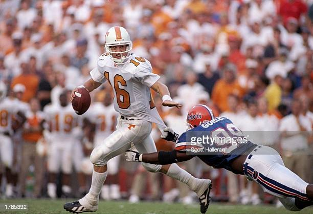 Quarterback Peyton Manning of the Tennessee Volunteers looks to pass the ball during a game against the Florida Gators at Florida Stadium in...