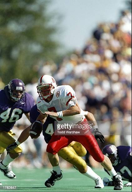 Quarterback Scott Frost of the University of Nebraska scrambles with the football during the Cornhuskers 2714 win over the University of Washington...