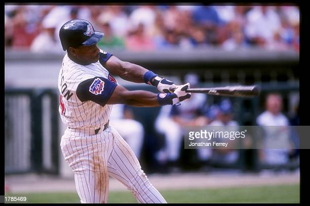 Rickey Henderson of the Anaheim Angels swings at the ball during a game against the Kansas City Royals at Anaheim Stadium in Anaheim California The...