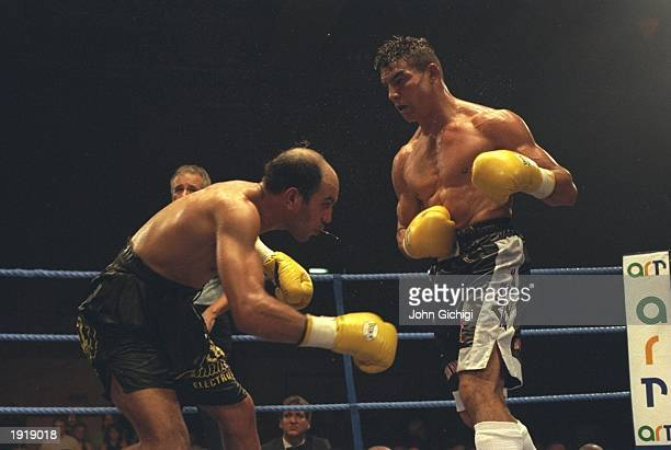 Robin Reid of England has Hassine Cherifi of France struggerling to keep his feet during the WBC Super Middleweight bout at Widnes Leisure Centre in...