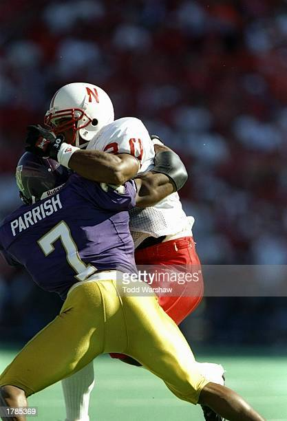 Running back Ahman Green the Nebraska Cornhuskers and defensive back Tony Parrish of the Washington Huskies tangle up during a game at Husky Stadium...