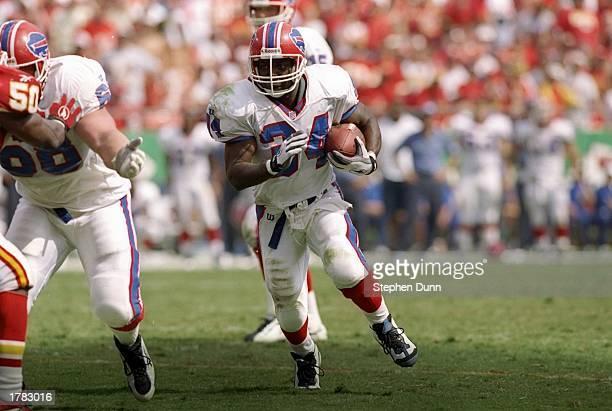 Running back Thurman Thomas of the Buffalo Bills runs with the football during a game against the Kansas City Chiefs at Arrowhead Stadium in Kansas...