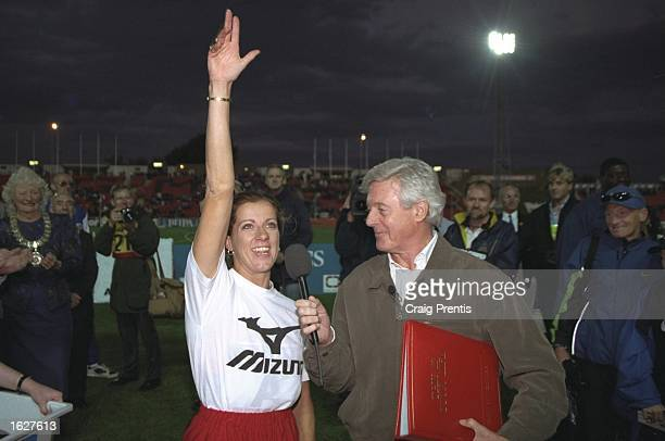 Sally Gunnell of Great Britain acknowledges the crowd as Michael Aspel surprises her for This is Your Life after the IAAF Grand Prix II Bupa Series...