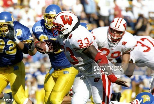 Tailback Ron Dayne of the Wisconsin Badgers runs with the ball during a game against the San Jose State Spartans at Spartan Stadium in San Jose...