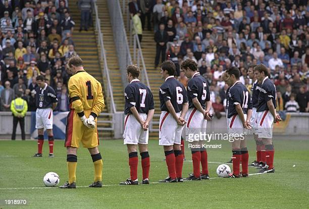 The Scotland team observe a one minute's silence in respect for Diana Princess of Wales before the World Cup Qualifier against Belarus at Pittodrie...