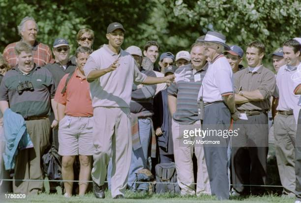 Tiger Woods looks on during the Canadian Open at the Royal Montreal Golf Course in Montreal Quebec