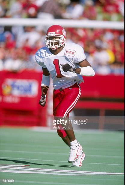 Wide receiver Kevin Dyson of the Utah Utes moves down the field during a game against the Louisville Cardinals at Cardinal Stadium in Louisville...