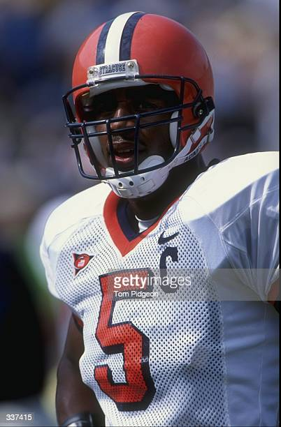 A portrait of quarterback Donovan McNabb of the Syracuse Orangeman as he stands on the field during the game against the Michigan Wolverines at...
