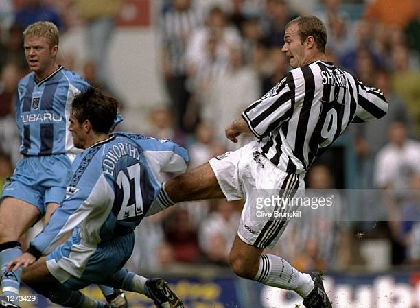 Alan Shearer of Newcastle scores a goal during the FA Carling Premiership match against at Highfield Road in Coventry England Newcastle won the game...