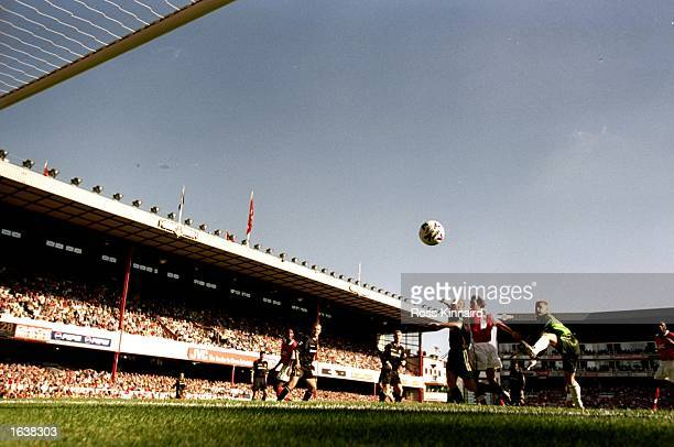 Arsenal captain Tony Adams rises above Jaap Stam of Manchester United and keeper Peter Schmeichel to score the opener during the FA Carling...