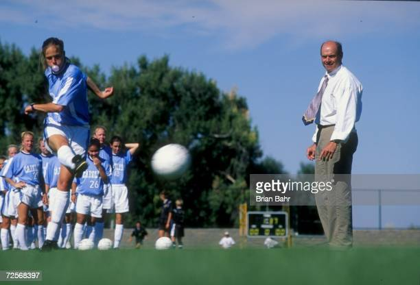 Assistant coach Bill Palladino of the North Carolina Tar Heels watches Charlotte Mitchell in action during a women''s soccer game against the...