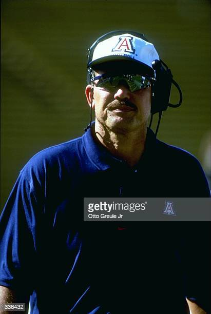 Associate coach Duane Akina of the Arizona Wildcats looks on during a game against the Stanford Cardinal at the Stanford Stadium in Stanford...