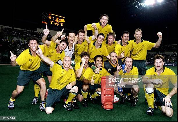 Australia celebrate after victory in the hockey final over Malaysia during the Commonwealth Games in Kuala Lumpur Malaysia Mandatory Credit Alex...