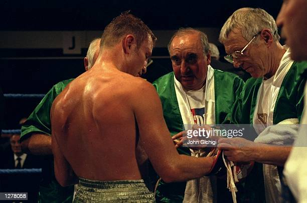 Danny Mancini has his glove unstrapped after his fight held at Bethnal Green London Mandatory Credit John Gichigi /Allsport