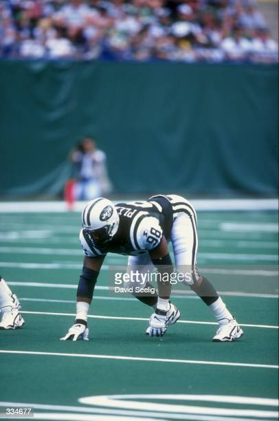 Defensive end Anthony Pleasant of the New York Jets in action during the game against the Baltimore Ravens at The Meadowlands in East Rutherford New...