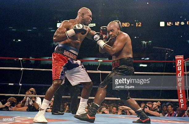 Evander Holyfield throws a left hand at Vaughn Bean in the 12th round of their IBF/WBA Heavyweight Championship bout at the Georgia Dome in Atlanta,...