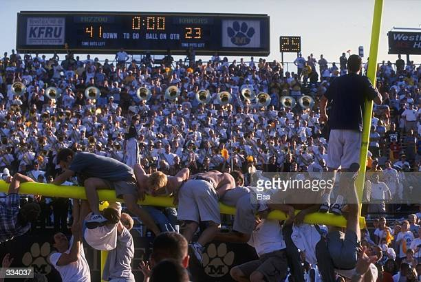 Fans celebrate by hanging from the goal post after the Missouri Tigers defeat the Kansas Jayhawks at Faurot Field in Columbia, Missouri. Missouri...