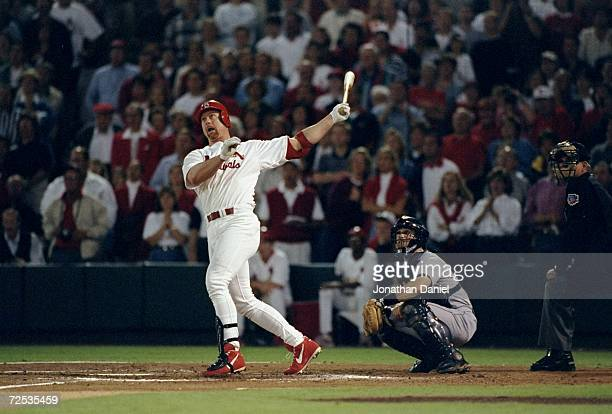 First baseman Mark McGwire of the St Louis Cardinals hits a pitch during a game against the Houston Astros at Busch Stadium in St Louis Missouri The...