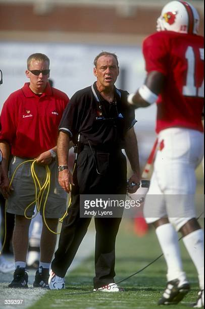 Head coach John L Smith of the Louisville Cardinals looks on during a game against the Kentucky Wildcats at the Papa John''s Cardinal Stadium in...