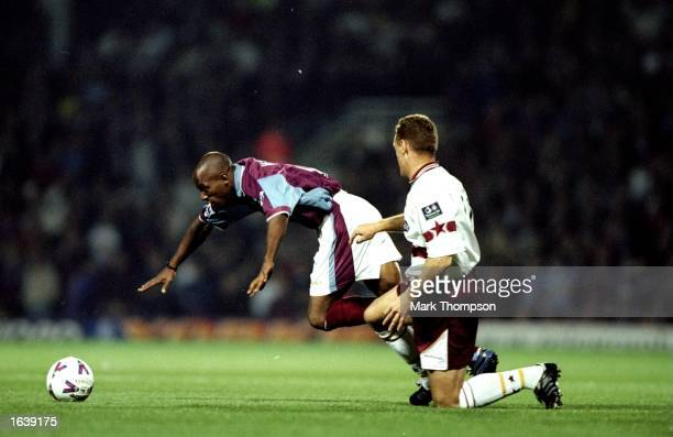 Ian Wright of West Ham is tackled by Colin Hill of Northhampton during the FA Carling Premiership match against Northhampton at Upton Park in London...