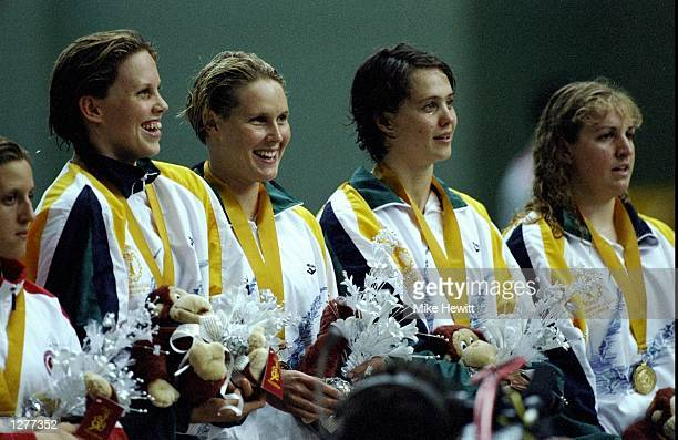 Julia Greville with Susie O''Neill and Ann Windsor and Lori Munz take Gold in the womens 4x200m free relay at the Commonwealth Games in Kuala Lumpur...