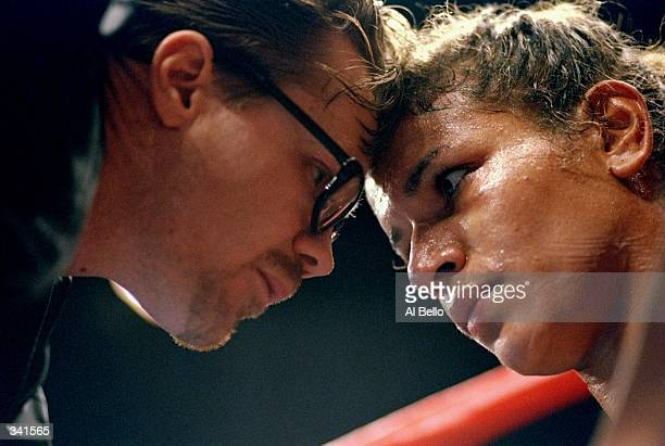 Lucia Rijker receives instructions from trainer Freddie Roach during her bout with Marcela Avna at the Foxwoods Casino in Ledyard, Connecticut....