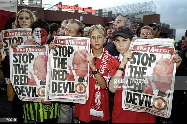 Manchester United fans protest against Rupert Murdoch's BSkyB takeover during the FA Carling Premiership match against Charlton Athletic at Old...
