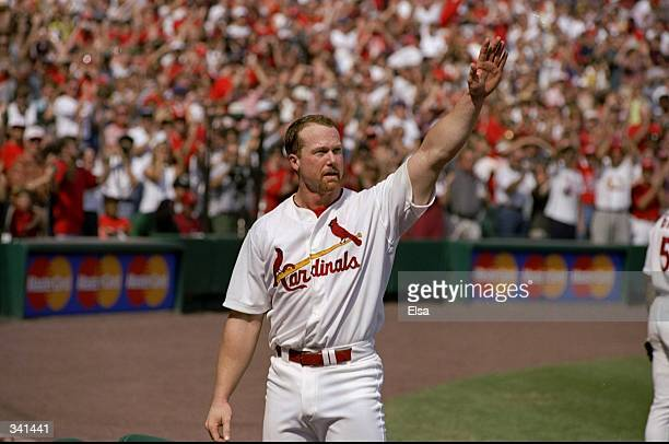Mark McGwire of the St Louis Cardinals acknowledges the fans after hitting his 70th home run of the season during a game against the Montreal Expos...