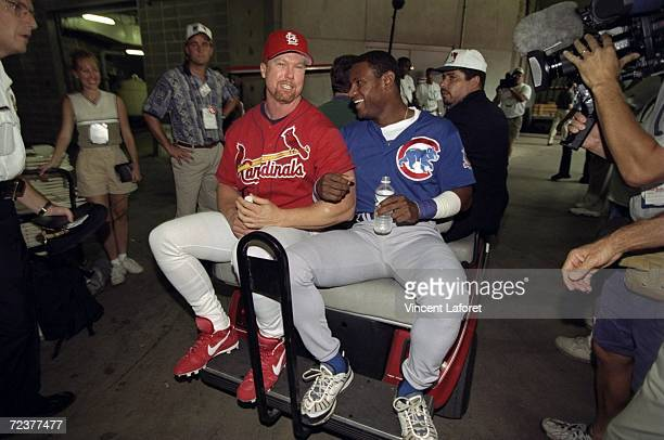 Mark McGwire of the St Louis Cardinals and Sammy Sosa of the Chicago Cubs ride on the back of a cart following McGwire''s 61st home run of the season...