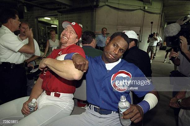Mark McGwire of the St Louis Cardinals and Sammy Sosa of the Chicago Cubs share a laugh following McGwire''s 61st home run of the year press...