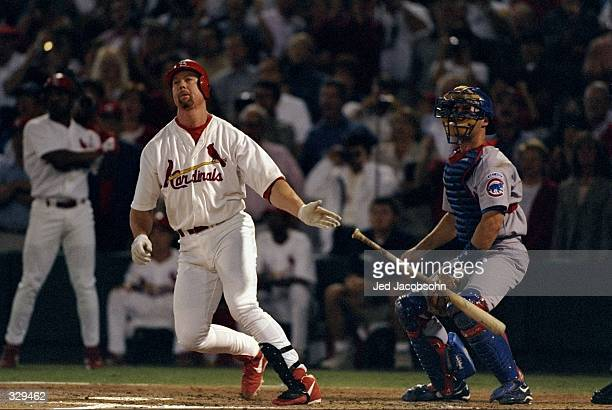 Mark McGwire of the St. Louis Cardinals hits his 62nd home run during the game against the Chicago Cubs at the Busch Stadium in St. Louis, Missouri....