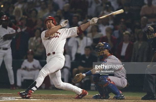 Mark McGwire of the St Louis Cardinals hits his 62nd home run during the game against the Chicago Cubs at the Busch Stadium in St Louis Missouri The...