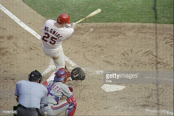 Mark McGwire of the St Louis Cardinals hits his 70th home run of the season during a game against the Montreal Expos at the Busch Stadium in St Louis...